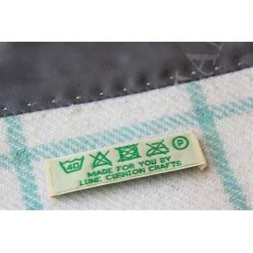 Étiquette tissée de lavage